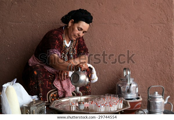 MARRAKECH, MOROCCO - AUGUST 8 : A Berber woman performs the traditional ceremony of making mint tea on August 8, 2008 in Marrakech, Morocco.