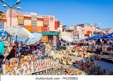 MARRAKECH, MOROCCO - DECEMBER 11: Carpets, crafts and souvenirs for sale at tourist market in Marrakech downtown. December 2016
