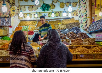MARRAKECH, MOROCCO - DECEMBER 11: People buying the dry fruits in the local shop in Marrakech. December 2016