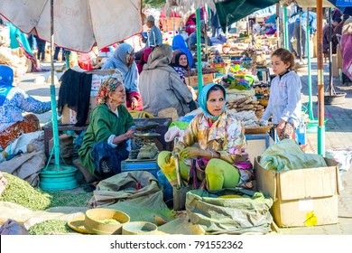 MARRAKECH, MOROCCO - DECEMBER 11: Women selling spices and vegetables at the market in Marrakech. December 2016