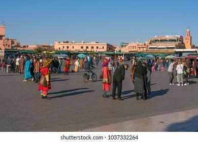 Marrakech, Morocco - December 25, 2017: People on Jamaa el Fna market square. Jemaa el-Fnaa, Djema el-Fna or Djemaa el-Fnaa is a famous square and market place in Marrakesh.