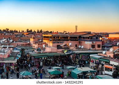Marrakech, Morocco - December 25, 2017: People onJamaa el Fna market square. Jemaa el-Fnaa, Djema el-Fna or Djemaa el-Fnaa is a famous square and market place in Marrakesh.