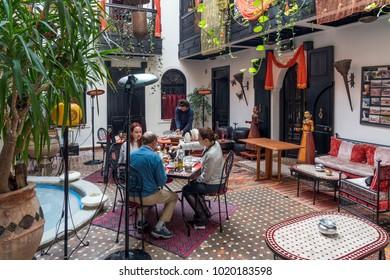 Marrakech, Morocco - December 26, 2017: People taking breakfast in Read Secret de Zoraida, a small family hotel in medina (old town) of Marrakech.