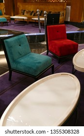 MARRAKECH, MOROCCO - FEB 18, 2019 - Primary colored chairs in lobby of Movenpick Hotel, Marrakech,  Morocco, Africa