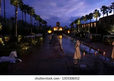 MARRAKECH, MOROCCO - FEB 18, 2019 - Night lights on plaza and pool of luxury hotel Selman, Marrakech,  Morocco, Africa