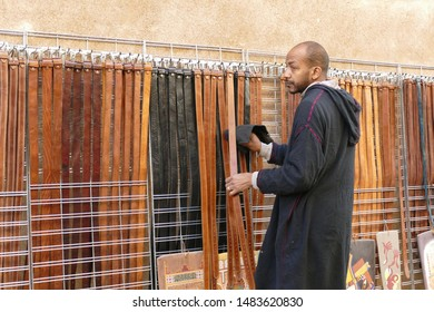 MARRAKECH, MOROCCO - FEB 18, 2019 - Selling leather belts in the medina bazaar of Marrakech,  Morocco, Africa