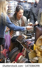MARRAKECH, MOROCCO - FEB 19, 2019 - Tourists explore the narrow paths and shops in the medina near the Djemma el Fna, Marrakech,  Morocco, Africa