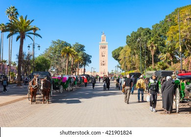 MARRAKECH, MOROCCO - FEBRUARY 22, 2016: Horse carriage and outoubia Mosque at Jemaa el Fna square and market place in Marrakesh's medina quarter.