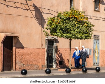 MARRAKECH, MOROCCO, JAN 15, 2019: two women walk in the streets of Marrakesh wearing traditional Islamic clothes, Morocco