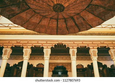 Marrakech, Morocco -January 16, 2018: Interior of Marrakech museum located in The Dar Menebhi Palace in Marrakech, Morocco. Decorated courtyard with a large brass chandelier.
