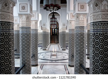 Marrakech, Morocco -January 18, 2018: Mamounia Palace Hotel interior in Marrakech, Morocco. Ornamental pillars with oriental patterned tiles.