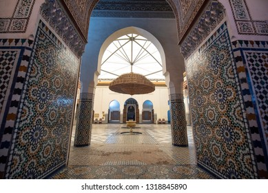 Marrakech, Morocco - June 22, 2019: Inside Interior of Marrakech museum located in The Dar Menebhi Palace. Decorated courtyard with a large brass chandelier from wood. Musee de Marrakech courtyard