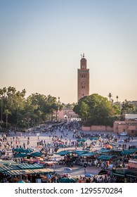 MARRAKECH, MOROCCO - JUNE 3, 2018: Famous Jemaa el Fna square near the famous minaret of the Koutoubia mosque in Marrakech, Morocco, Africa