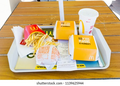 Marrakech, Morocco - June 5, 2018: Two P'tits Plaisirs sandwich, cheeseburger, french fries and Sprite for drink in McDonald restaurant.