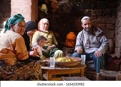 Marrakech, Morocco - Mar 09 2007: A Berber family eat a traditional tagine meal in a Moroccan house near Marrakech, Morocco