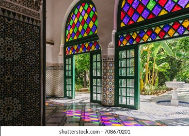 MARRAKECH, MOROCCO - MAY 15, 2017:  interior of the Dar si Said Museum, with beautiful islamic decorations on the wall and multicolored glasses on the doors that cast colored lights on the floor