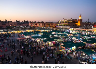 MARRAKECH, MOROCCO; NOV 13: Sunset at the Jamaa el Fna Square on November 13, 2017 in Marrakech, Morocco. The center of public life in Marrakech. It is frequented daily by thousands of Tourists
