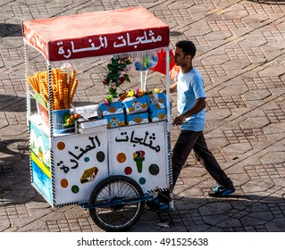 MARRAKECH, MOROCCO, NOV 14, 2013: Unidentified street ice cream vendor at Djemaa el Fna square, Marrakech, Morocco.