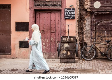 Marrakech, Morocco - November 2016: Woman in traditional clothes walking on the street in Marrakech in November 2016