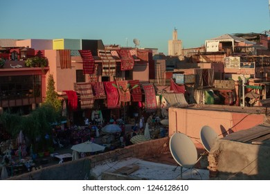 Marrakech, Morocco - October 17, 2018: View from the terrace of a cafe to the row of shopping stalls on the Djemaa el Fna square