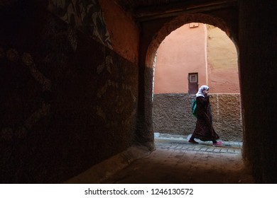 Marrakech, Morocco - October 18, 2018: Woman speaking on the cell phone walks down the street