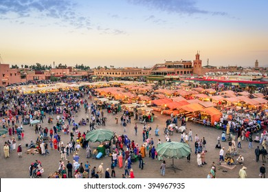MARRAKESH, MAROCCO - NOVEMBER 14, 2015: aerial view of people walking on Jemaa EL Fnaa main city square. Crowd at warm sunset color tones at market place in Marrakesh's medina quarter.