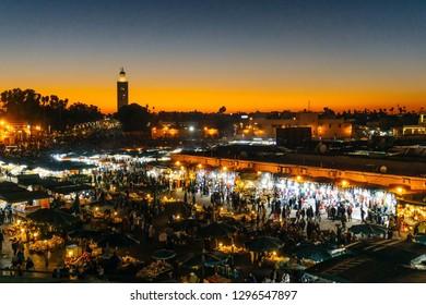 Marrakesh Medina (Marrakech Medina). Jamaa el Fnaa square or Jemaa el-Fna, Djema el-Fna, Djema el-Fnaa market place and Koutoubia mosque minaret