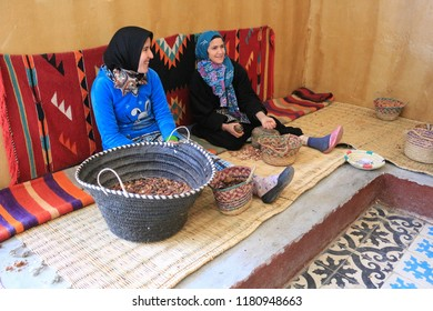 Marrakesh, Morocco - 2016-03-02 : Ladies working to grind argan nuts to make oil, butters and other products, near Marrakesh, Morocco, Africa