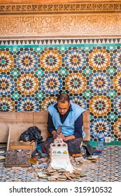 MARRAKESH, MOROCCO, APRIL 16, 2015: Local artisan works in the Ben Youssef Madrasa
