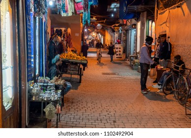MARRAKESH, MOROCCO - DECEMBER 26, 2017: People in the medina of Marrakesh at night. Marrakesh is the most popular tourist destination in Morocco.