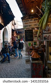 MARRAKESH, MOROCCO - DECEMBER 26, 2017: People in a market of medina of Marrakesh. Marrakesh is the most popular tourist destination in Morocco.