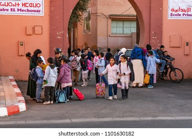 MARRAKESH, MOROCCO - DECEMBER 7, 2017: Children leaving the school in the medina of  Marrakesh. With a population of over 900,000 inhabitants it is the most important city in Morocco.