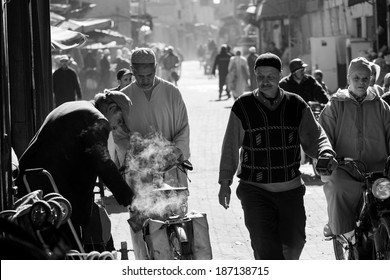 MARRAKESH ,MOROCCO - FEBRUARY 11: Unidentified people at a street in Marrakesh on FEBRUARY 11, 2014 in Morocco. With a population of over 900,000 inhabitants it is the most important city in Morocco.