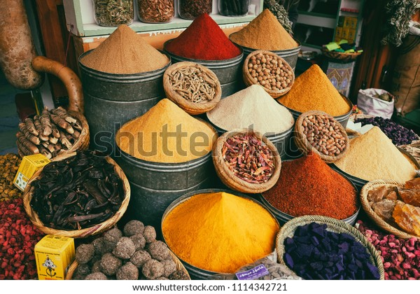 Marrakesh, Morocco - January 18, 2018: Piles of traditional spices in souk, market in medina of Marrakech, Morocco.