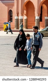 MARRAKESH, MOROCCO - JULY 2015. Streets of Marrakesh with anonymous people walking through them. The city has the largest traditional market in the country and one of the busiest squares in Africa.