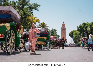 Marrakesh, Morocco - July 25th 2018 : View of Koutoubia mosque surrounded by tourists