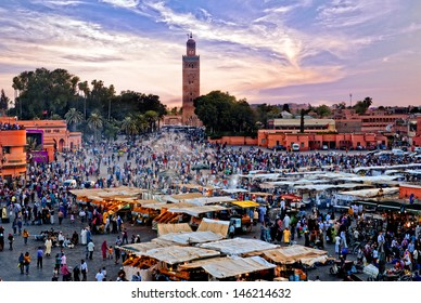 MARRAKESH, MOROCCO - JUNE 3: Unidentified people visit the Jemaa el Fna Square at sunset on June 3, 2013 in Marrakesh, Morocco. The square is part of the UNESCO World Heritage.