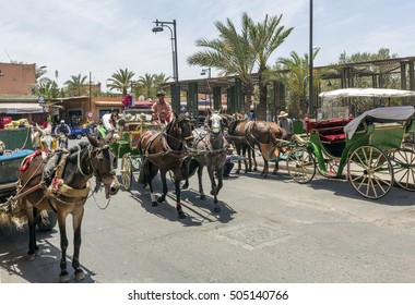 MARRAKESH ,MOROCCO - JUNE 4: Unidentified tourists in the medina of  Marrakesh on June 4, 2013 in Morocco. With a population of over 900,000 inhabitants it is the most important city in Morocco.