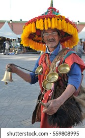 MARRAKESH, MOROCCO - MARCH 17, 2012: Water-bearer in the typical and traditional costume of the region, in the Jemaa el Fna square, historic center of the city