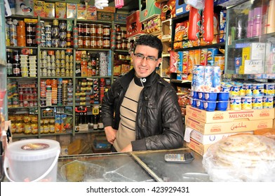 MARRAKESH, MOROCCO - MARCH 18, 2014: A trader in his small shop, souk of Marrakesh