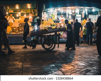 MARRAKESH, MOROCCO - March 27, 2018: Medina of Marrakesh at Djemaa el Fna square at night, crowded with tourists