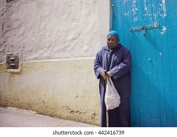 MARRAKESH ,MOROCCO - MAY 8: Unidentified old man at a street in Marrakesh on MAY 8, 2016 in Morocco. With a population of over 900,000 inhabitants it is the most important city in Morocco.