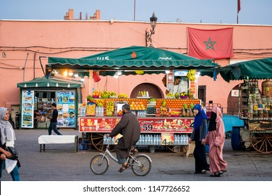 Marrakesh, Morocco - November 08, 2017: Fruits seller on Moroccan market square Jamaa el Fna in Marrakesh medina quarter, called also Jemaa el-Fnaa, Djema el-Fna or Djemaa el-Fnaa