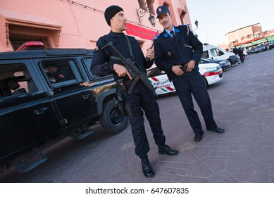 MARRAKESH, MOROCCO - NOVEMBER 10: Moroccan police stand guard in Jemaa el-Fnaa, the central market plaza in Marrakesh, Morocco, November 10, 2016.