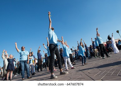 MARRAKESH, MOROCCO - NOVEMBER 10: Young activists at the COP22 UN climate summit take part in a flash-mob dance protest in Jemaa el-Fnaa, the central plaza in Marrakesh, Morocco, November 10, 2016.