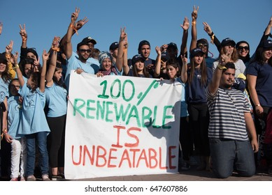 "MARRAKESH, MOROCCO - NOVEMBER 10: Young activists at the COP22 UN climate conference hold a sign reading ""100% Renewable is Unbeatable"" at a demonstration in Marrakesh, Morocco, November 10, 2016."