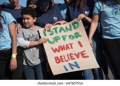 "MARRAKESH, MOROCCO - NOVEMBER 10: Young activists at the COP22 UN climate conference hold a sign reading ""I Stand Up For What I Believe In"" at a demonstration in Marrakesh, Morocco, November 10, 2016."