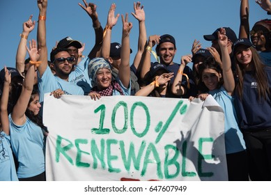"MARRAKESH, MOROCCO - NOVEMBER 10: Young activists at the COP22 UN climate conference hold a sign reading ""100% Renewable"" at a demonstration in Marrakesh, Morocco, November 10, 2016."