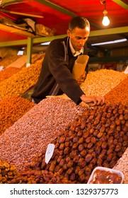 MARRAKESH, MOROCCO - OCTOBER 1, 2009: fruit and nut vendor in Djemaa el Fna plaza.