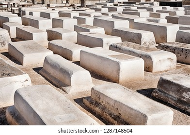 MARRAKESH, MOROCCO - OCTOBER 24, 2018: Anonymous white tombs mark the graves in the ancient Jewish cemetery and historic landmark in Marrakesh, Morocco.
